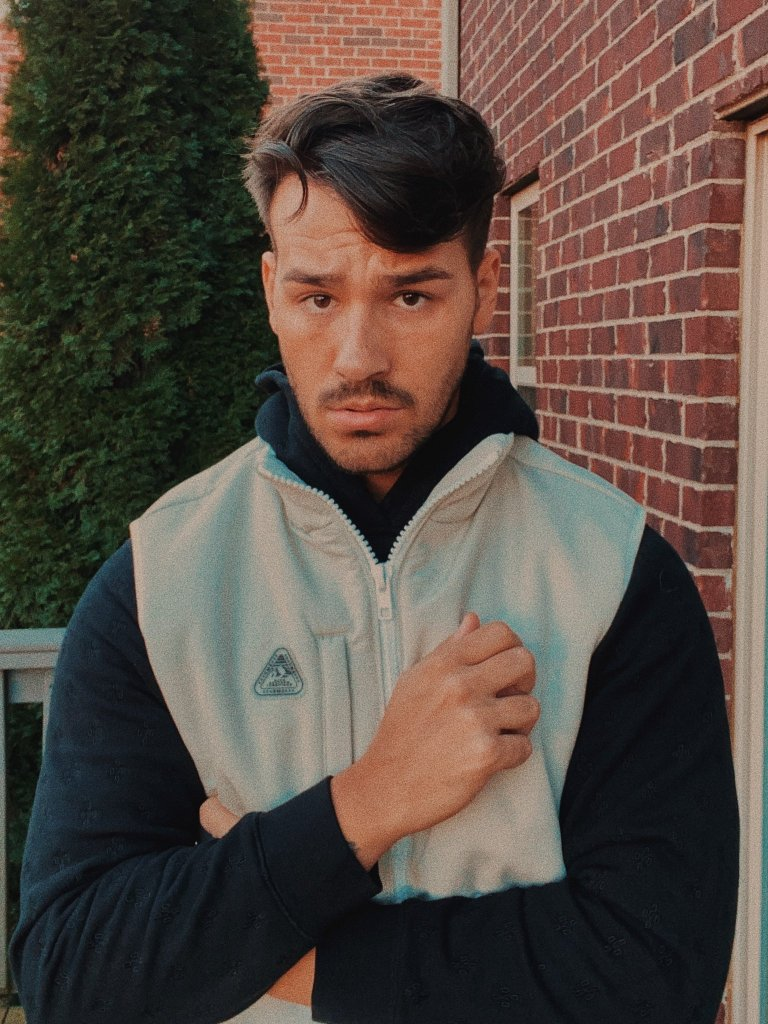 Jacob in front of a brick wall