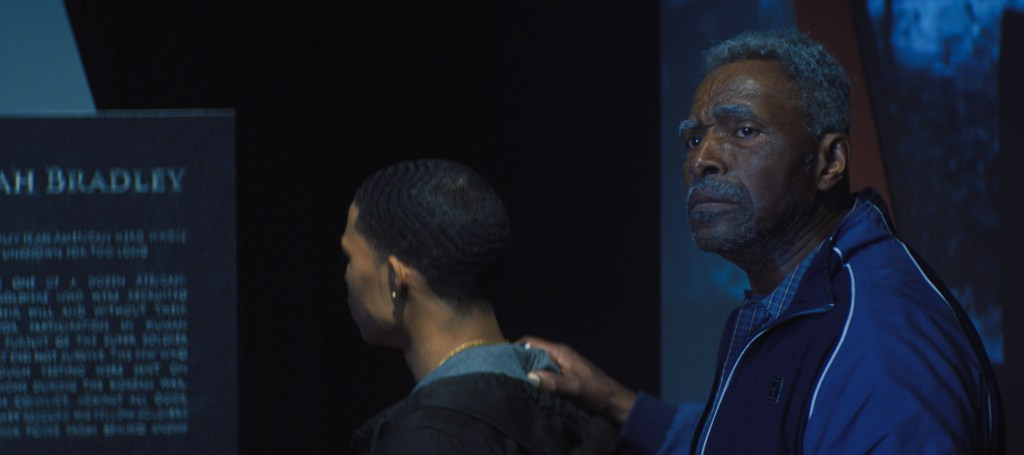 (L-R): Eli Bradley (Elijah Richardson) and Isaiah Bradley (Carl Lumbly) in Marvel Studios' THE FALCON AND THE WINTER SOLDIER.