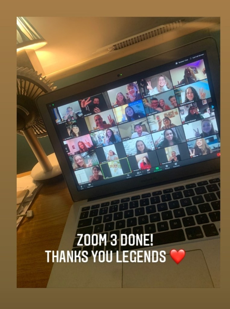 A photo of Tommy's laptop showing participants of a fan zoom call